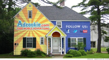 House painted with ads