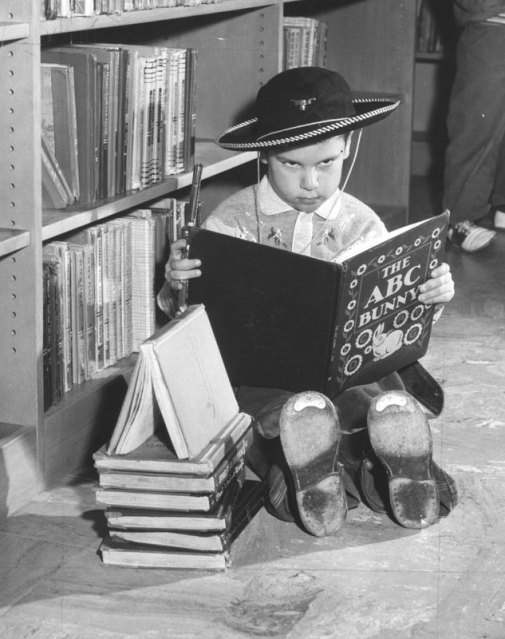 Child in a library with gun
